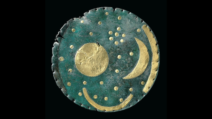The Nebra Sky Disk, 2100 to 1700 B.C. | The first attempt to say anything about the future is based on the definition of time. For example, the Nebra Sky Disc, a bronze disk about 3700 to 4100 years old, served as an astronomical clock. It seems to have been intended to harmonize the solar year (365 days) and the lunar year (354 days), whereby the position of the moon in relation to the Pleiades – a cluster of stars that is visible to the naked eye – functions like a pointer in this clock. The division of time into a calendar is an expression of an early idea of the future. It serves as a basis to take precautions and plan for the time beyond the present.  Credit: Photo: Juraj Lipták ; State Office for Monument Conservation and Archaeology Sachsen-Anhalt, www.landesmuseum-vorgeschichte.de  Work Data: The sky disk of Nebra; dated between 1700 and 1500 B.C., Location: Federal state museum for prehistory, Halle/Saale