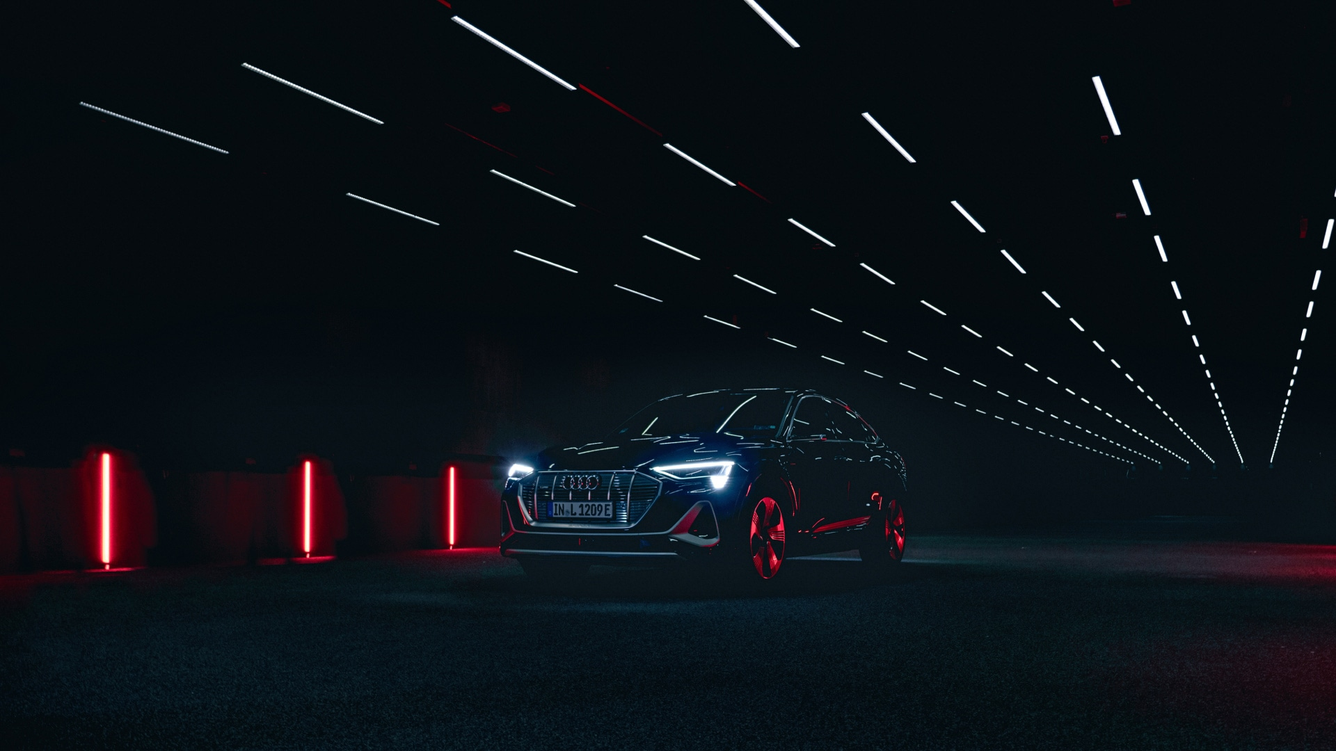 The digital matrix LED headlight can deliver cornering, city and highway lighting as versions of the low-beam light with ultra-high precision. The Audi e-tron Sportback 55 quattro with digital matrix LED headlights is shown above in the Audi light testing tunnel.
