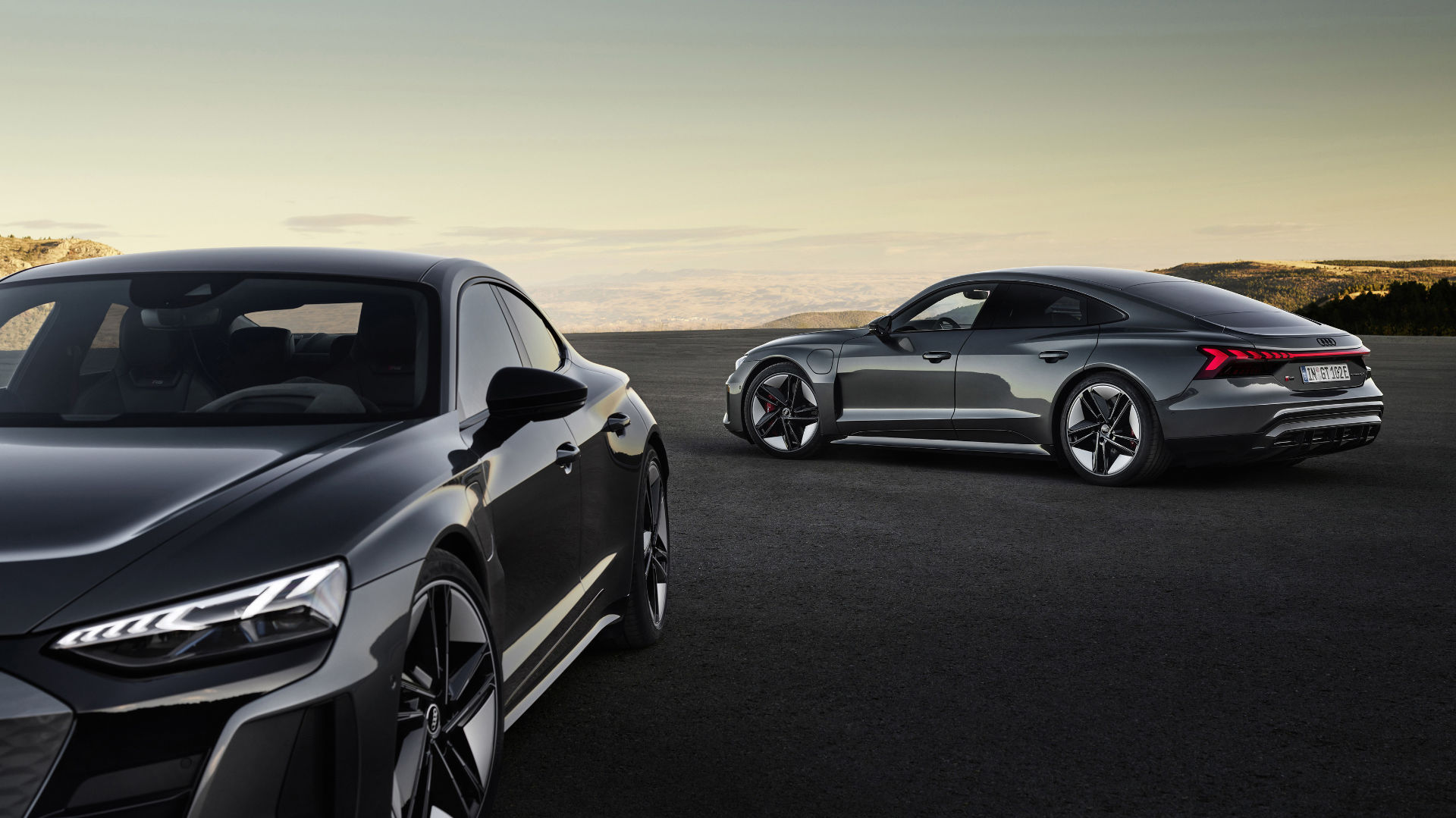 The new Audi e-tron GT quattro and Audi RS e-tron GT. Fully electric and produced at Böllinger Höfe, these vehicles combine forward-looking technologies with Audi's commitment to premium quality, and therefore symbolize the electrical performance of the future.