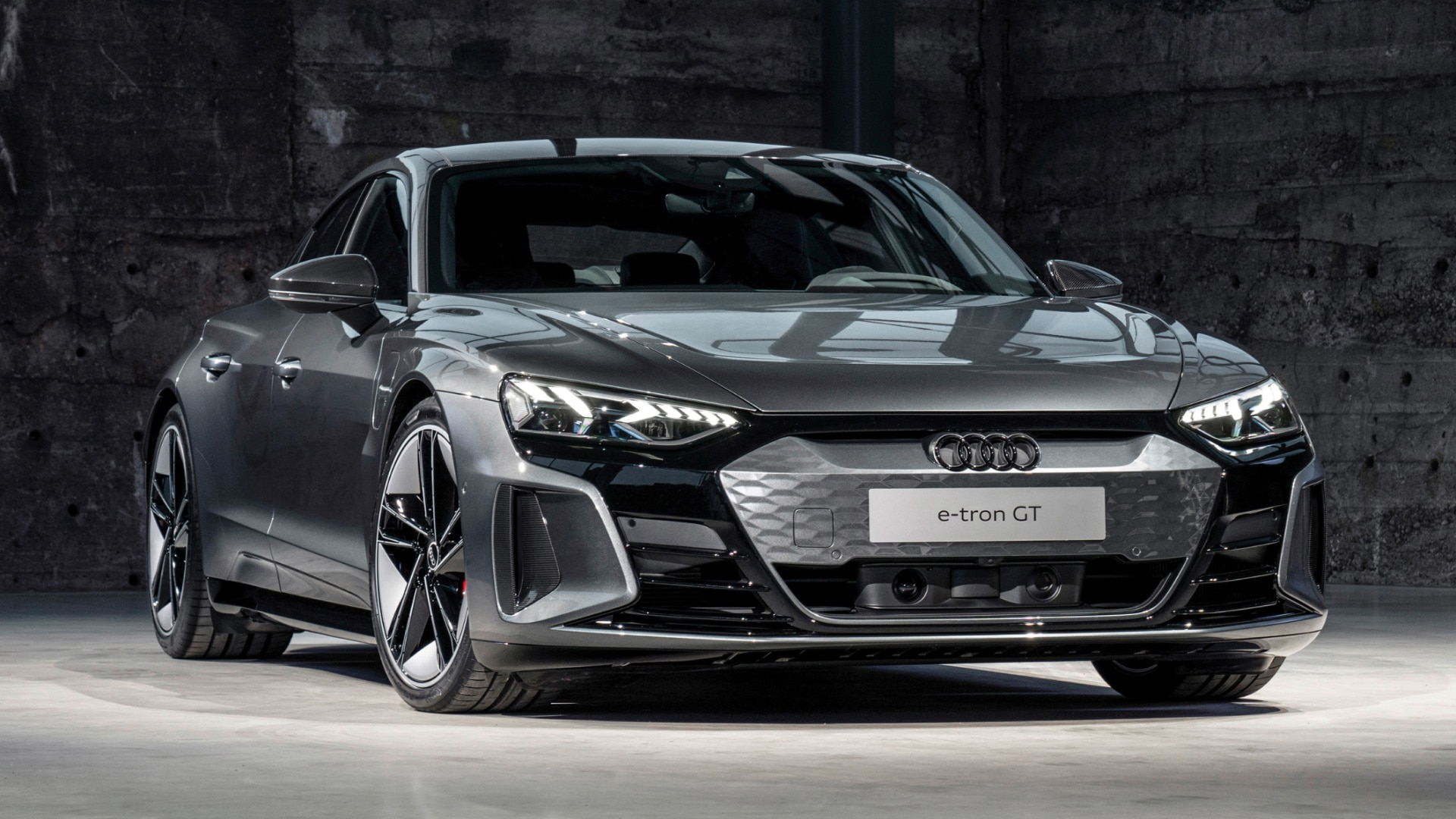 A Gran Turismo is a sporty touring car with excellent dynamic handling, a confident glider. The Audi e-tron GT shares this character.