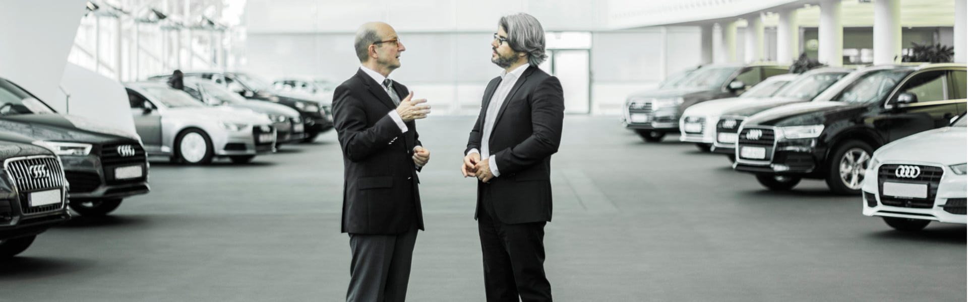 Heiko Schmidt, Head of Retailer Development/Training Germany at Audi, and Peter F. Tropschuh, Head of Strategy Sustainability at Audi, in conversation
