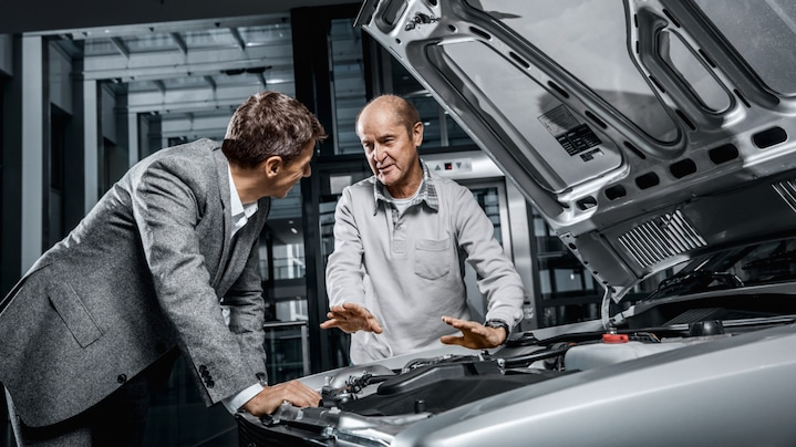 An Audi employee in conversation with a supplier