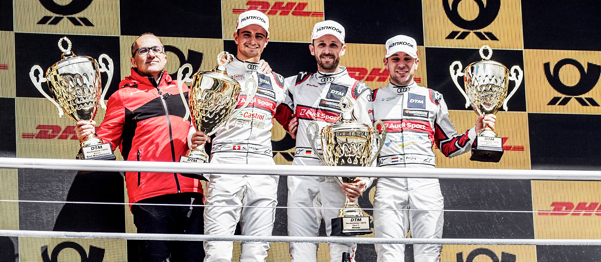 Nico Müller, René Rast and Robin Frijns on the podium