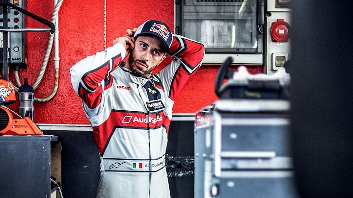 Andrea Dovizioso next to the Audi RS 5 DTM and Ducati Desmosedici GP