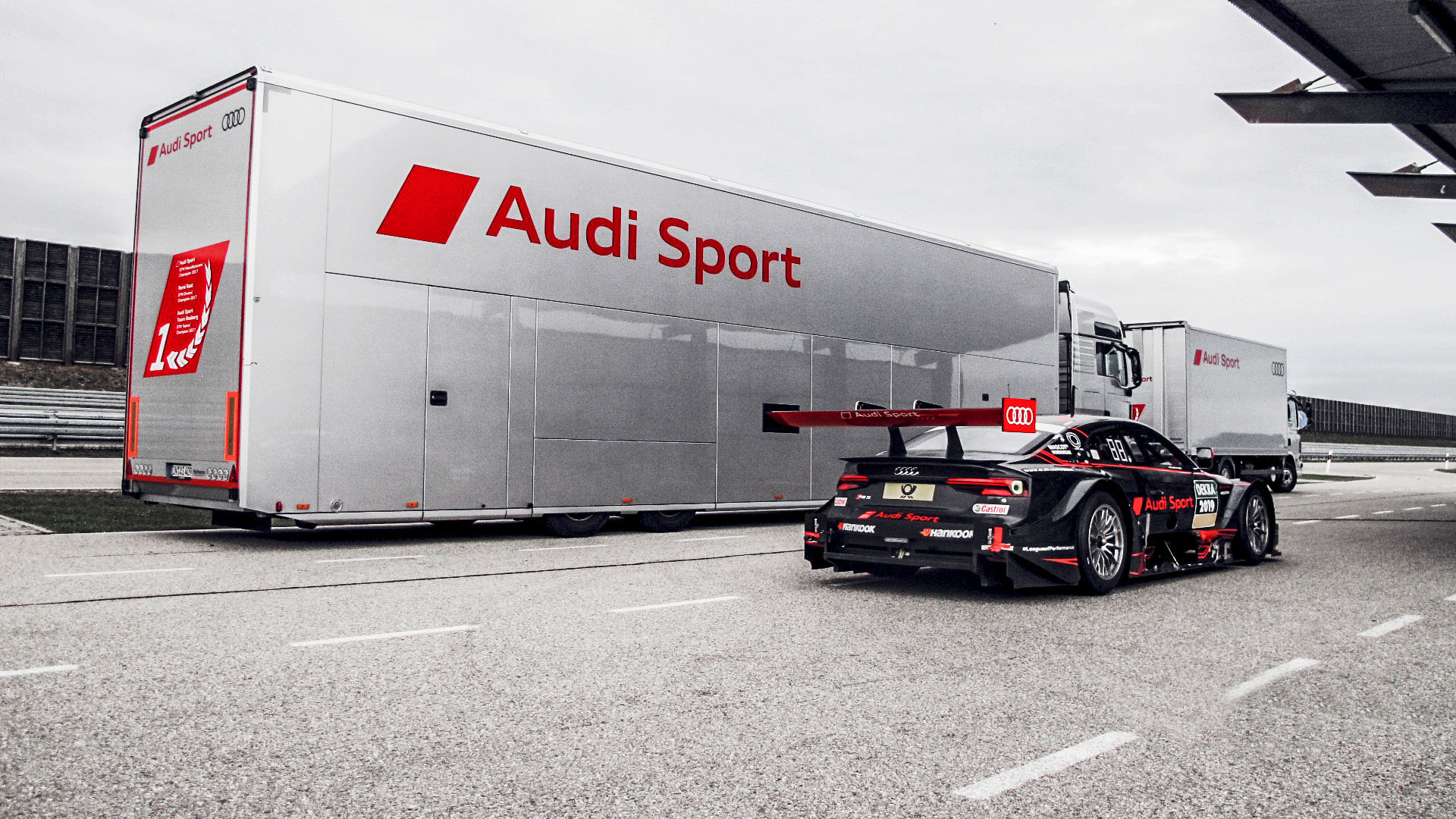 Audi RS 5 DTM in front of Audi Sport truck