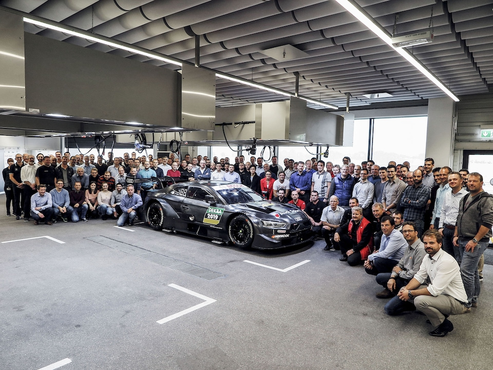 Audi Sport employees and the Audi RS 5 DTM