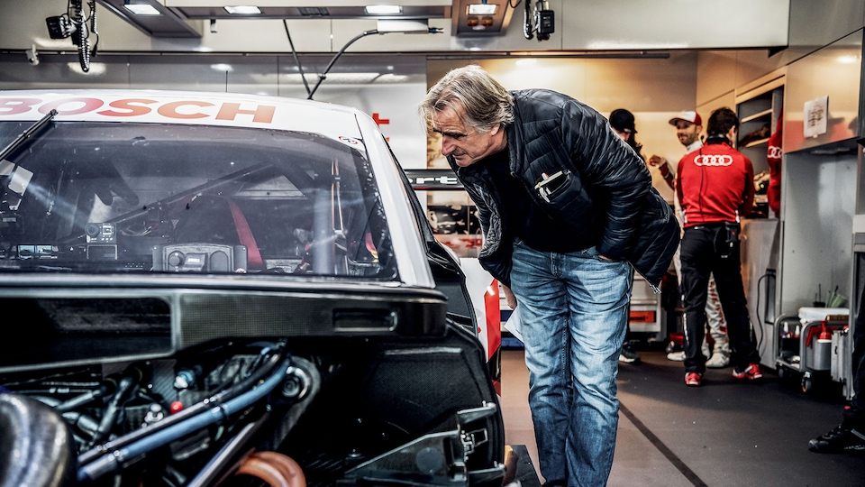 Roland Löwisch next to the Audi RS 5 DTM