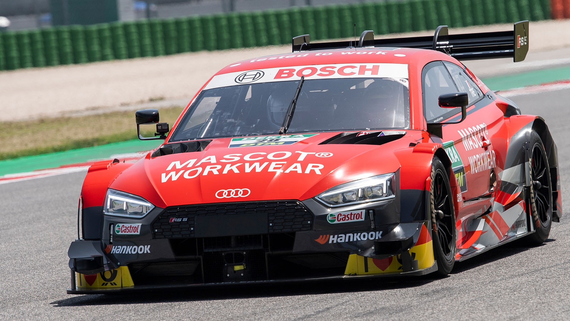 Audi RS 5 DTM race taxi on the racetrack