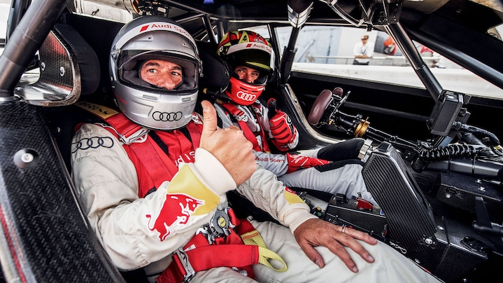 Benoît Tréluyer and a passenger in the Audi RS 5 DTM race raxi
