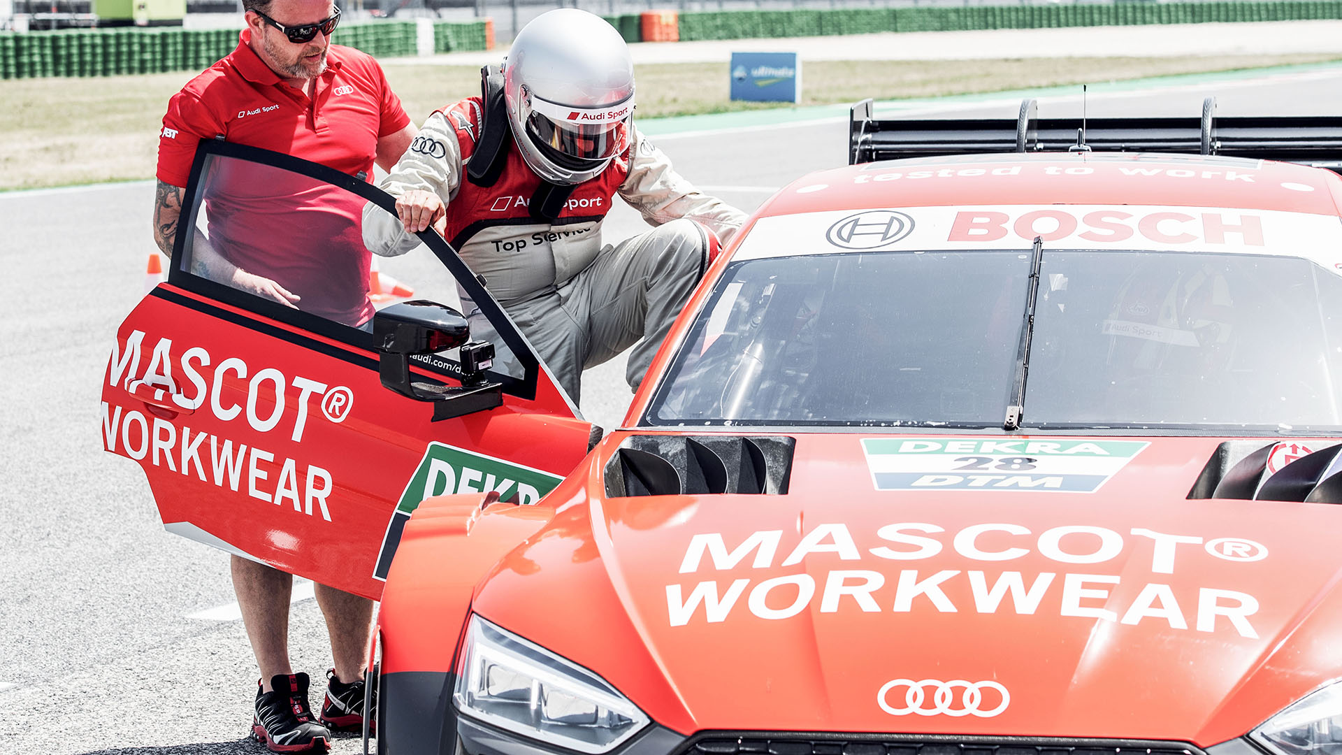 A passenger getting into the Audi RS 5 DTM race taxi