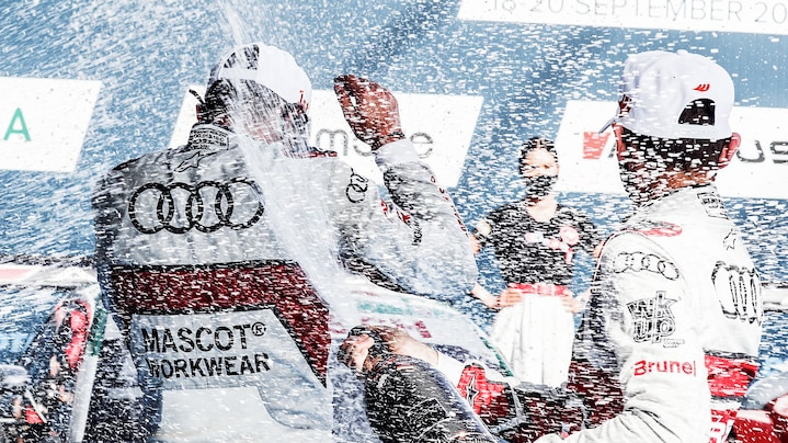 Audi drivers celebrating on the podium