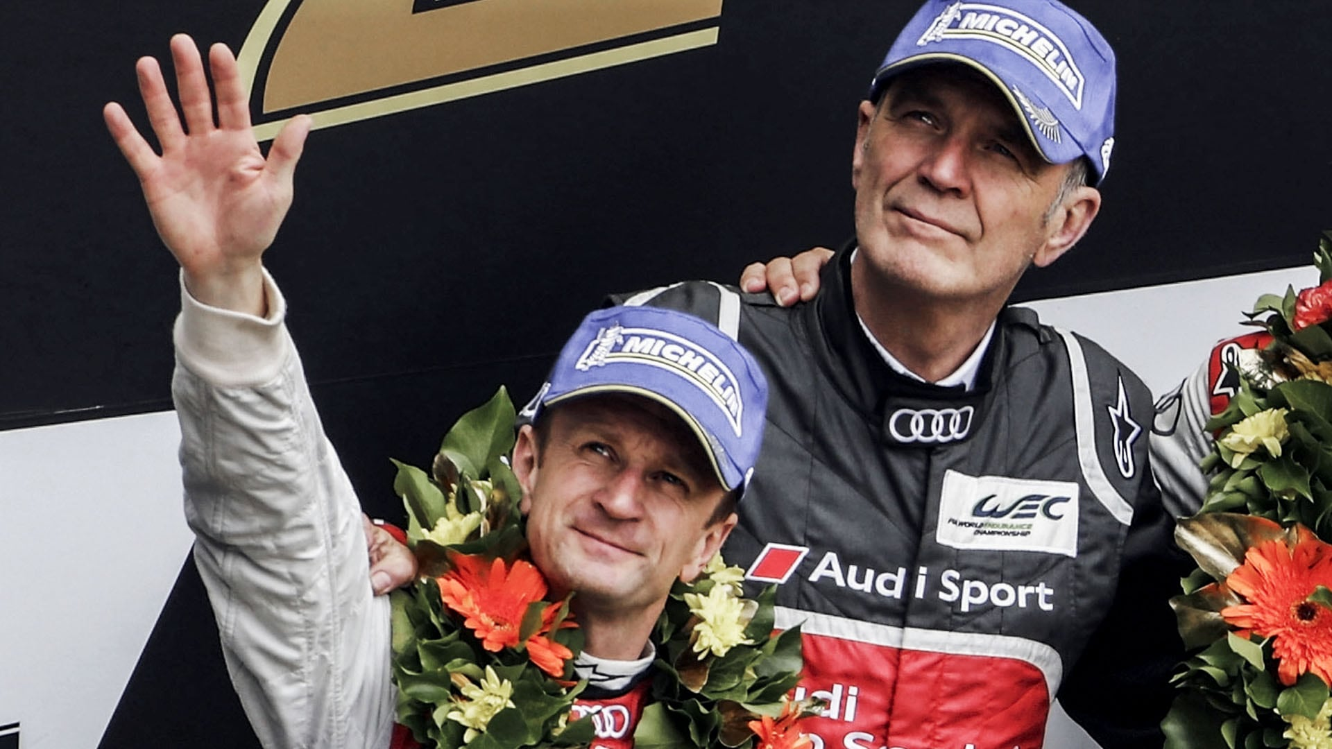 Allan McNish on the podium with Dr. Wolfgang Ullrich