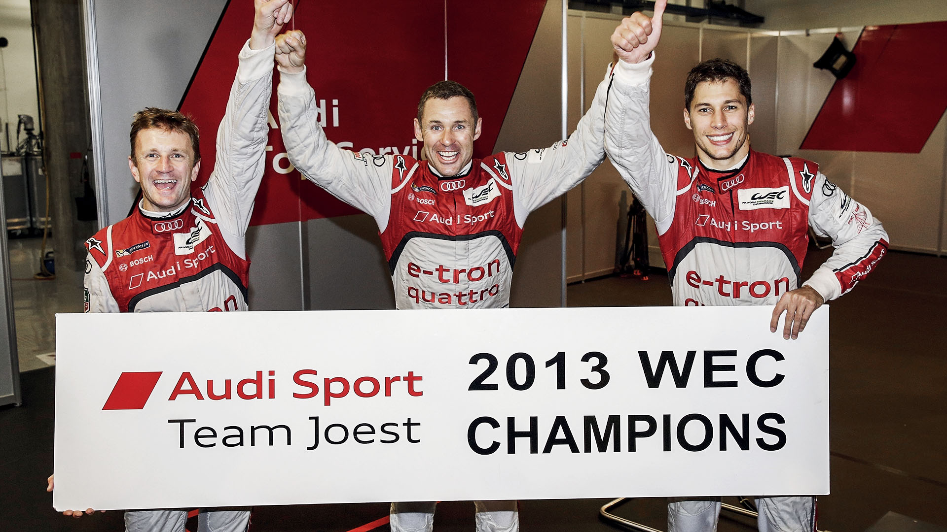 Allan McNish with Tom Kristensen and Loïc Duval and the Audi R18 e-tron quattro