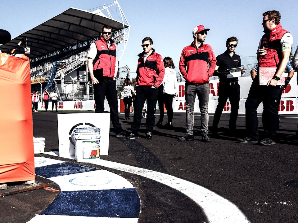 Drivers and engineers at the track walk