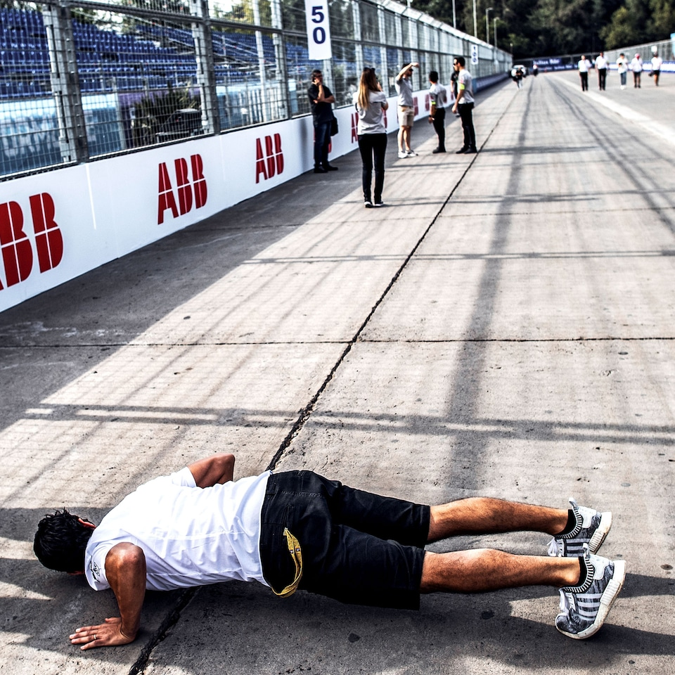 Man lies on racetrack