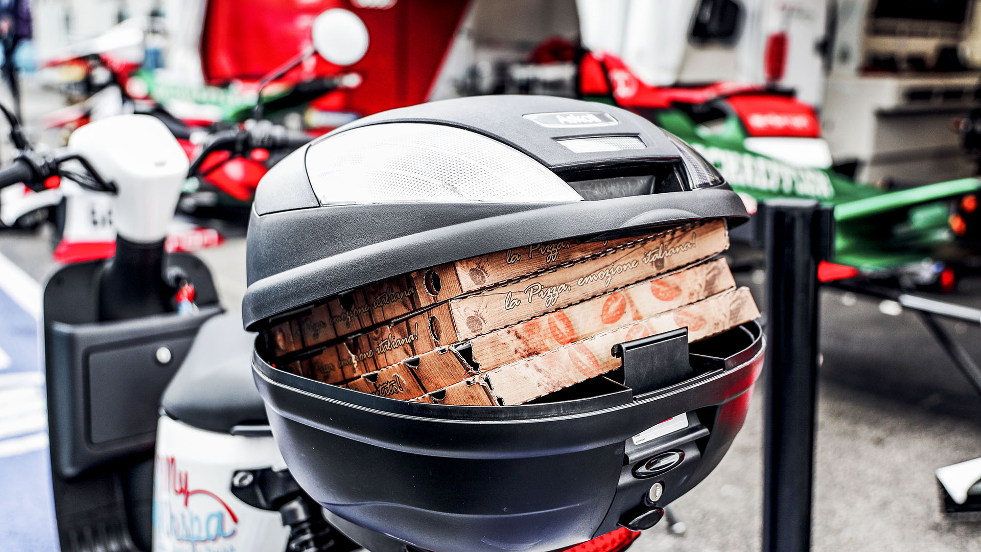 Pizza boxes and a motorcycle