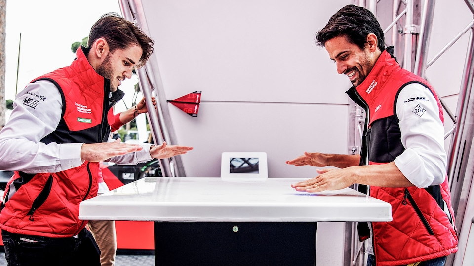 Daniel Abt and Lucas di Grassi playing a game