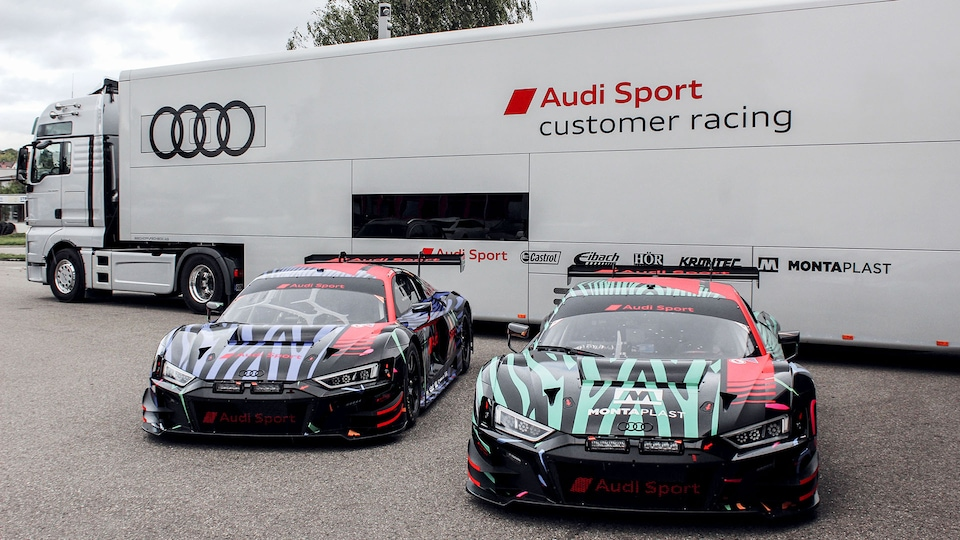 Audi R8 LMS next to a truck