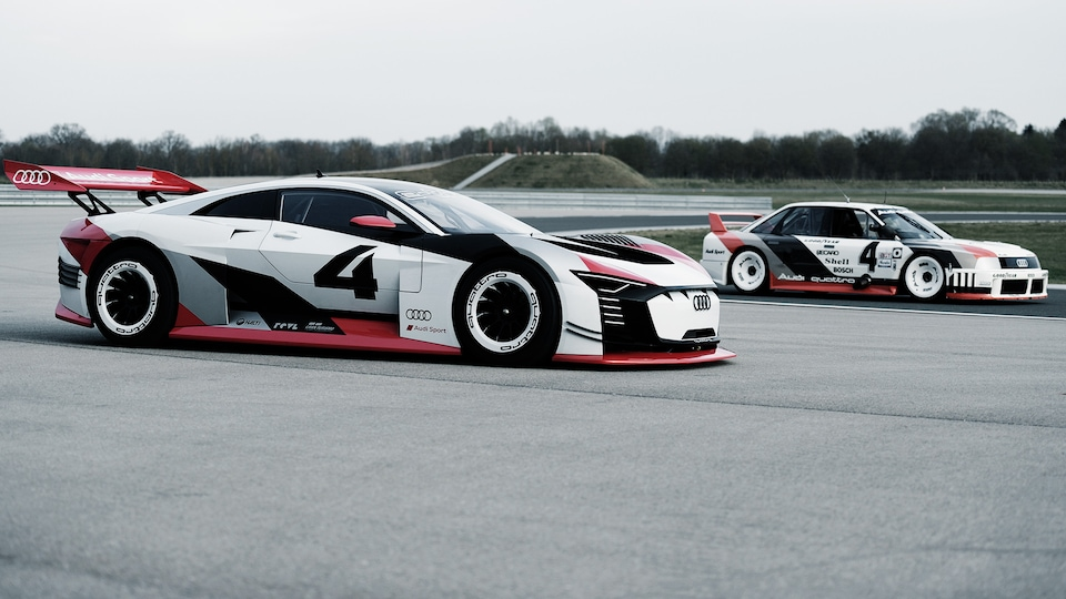 Audi 90 quattro IMSA GTO and Audi e-tron Vision Gran Turismo on the racetrack