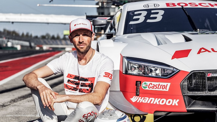 René Rast sitting next to his Audi RS 5 DTM
