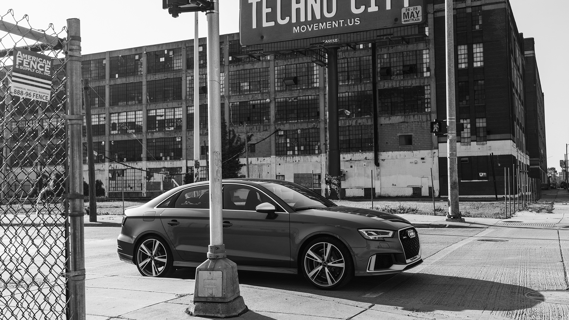 Audi RS 3 Sedan in front of industrial hall