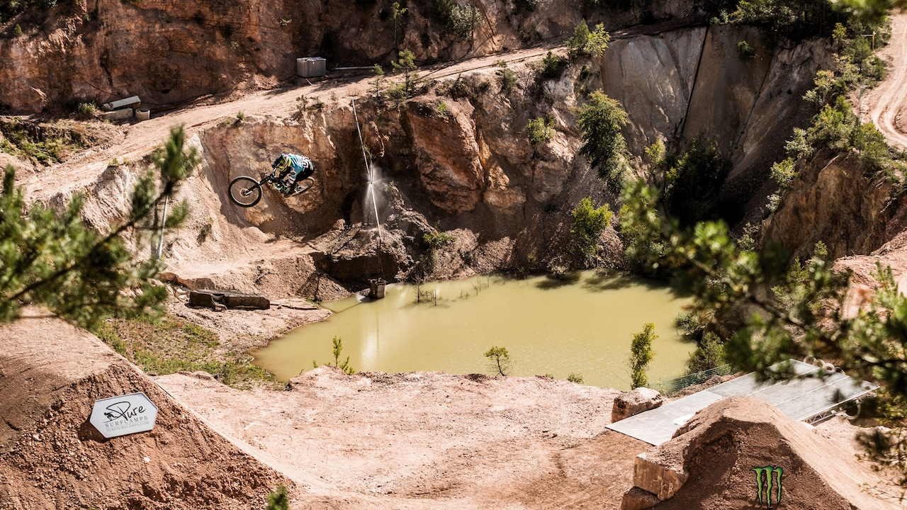 Airtime: In an abandoned quarry, Sam Reynolds shoots off a ramp high into the air. At the Audi Nines MTB, leaps like this won the Brit the Best Freeride Line title.