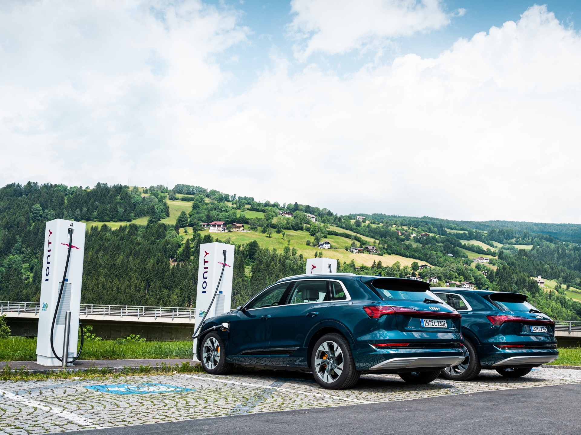 Three Audi e-trons at the IONITY quick-charging station.