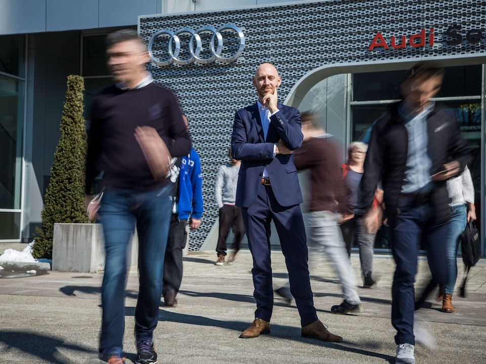 Martin Steca standing in front of Audi building