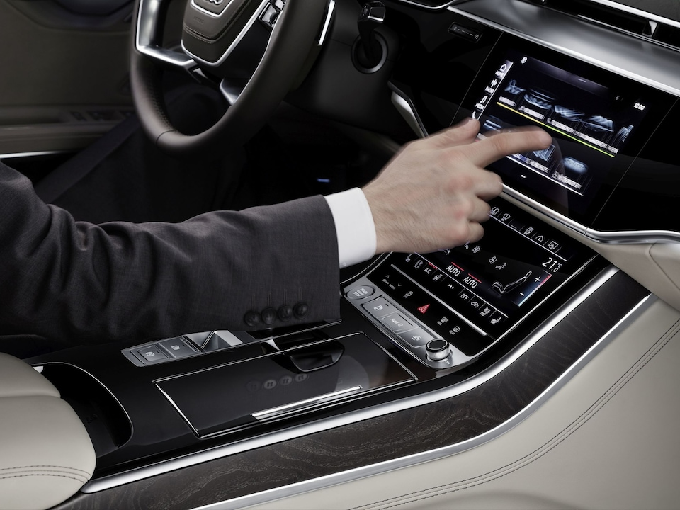 Both touchscreens in the new Audi A8 react to finger proximity or touch pressure-sensitive and with haptic feedback.